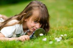 Girl with microscope Stock Image