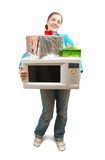 Girl with microwave oven and gifts Royalty Free Stock Images