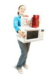 Girl with microwave  and present boxes Stock Images