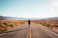 Girl in the middle of Route 66 Stock Photography