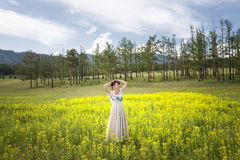 The girl is in the midst of flower fields. Royalty Free Stock Photo