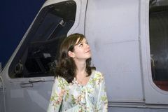 Girl with military aircraft Royalty Free Stock Photo