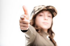 Girl in a military cap pretending to shoot Royalty Free Stock Images