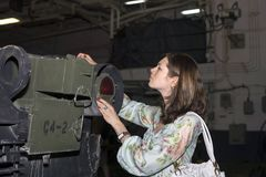 Girl with military vehicle royalty free stock photography