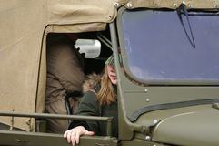 Girl In Military Vehicle. A girl about to open a door of a military vehicle with tarpaulin top royalty free stock images