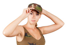 The girl in the military vest and a cap. Isolated on white background. Stock Images