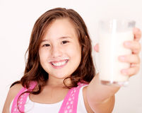 Girl and milk Royalty Free Stock Image
