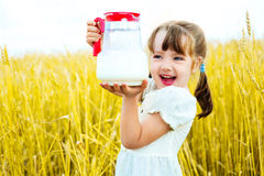 Girl with milk Stock Images