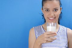 Girl with milk Stock Photography