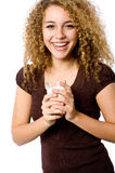 Girl With Milk. A pretty young woman holding a glass of milk royalty free stock image