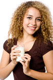 Girl With Milk. A young woman holding a glass of milk on white background royalty free stock photography