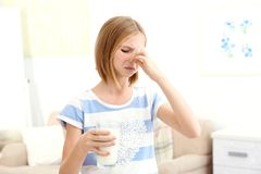 Girl with milk allergy at home royalty free stock photos