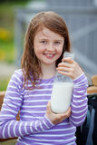 Girl With Milk Bottle At Campsite Royalty Free Stock Images