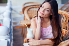Girl with milk cocktail Royalty Free Stock Photography