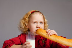 Girl with milk and French bread Royalty Free Stock Photos