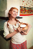 The girl with a milk jug Stock Photography
