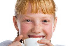 Girl with a milk mug Stock Image