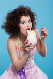 Girl with milk shake Stock Images