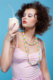 Girl with milk shake Stock Photography