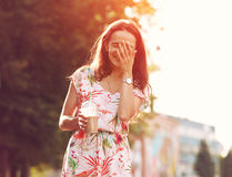 Girl with milk shake laughing Royalty Free Stock Image