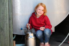 Girl with milkcan Royalty Free Stock Image