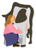 Girl Milks Cow. A redhead girl milks a spotted cow Stock Image