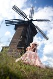 The girl and a mill. The sad girl. An ancient dress. Sinyachiha village, Ural Stock Image