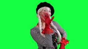 The girl mime flirting funny. The girl mime against a green background stock video