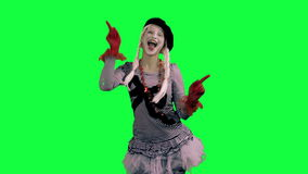 The girl mime funny dancing. The girl mime against a green background stock video