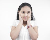 Girl miming hear no evil Stock Photo