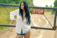 Girl in mini denim shorts standing at the turnpike Royalty Free Stock Photos