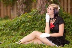 Girl in mini dress Stock Image