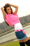 Girl in mini skirt Royalty Free Stock Image