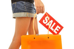 Young woman, mini skirt, orange bag Stock Image