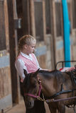 Girl with miniature horse at state fair Royalty Free Stock Images
