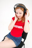 Girl in miniskirt with headset Stock Images