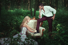Girl ministered to the man. Girl fastens laces on shoes men, she ministered to Stock Image