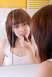 Girl in mirror Stock Images