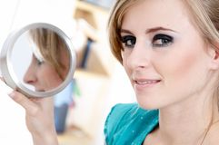 Girl with mirror. Portrait of pretty girl with mirror royalty free stock photos