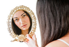 Girl and mirror Royalty Free Stock Images