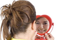 Girl and mirror stock photography