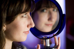 Girl with mirror Royalty Free Stock Photography