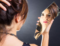 Girl in the mirror Royalty Free Stock Image