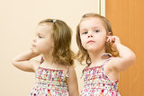 The girl before a mirror Royalty Free Stock Photography