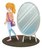 A girl beside a mirror Stock Photography