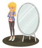 A girl beside a mirror Stock Photo