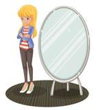A girl beside a mirror Stock Photo
