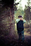 Girl misses the tree in a waistcoat in the woods Royalty Free Stock Photo