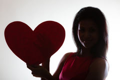 Girl mixed race with paper red heart Stock Photo