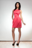 Girl mixed race in red dress posing Royalty Free Stock Photography